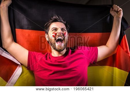 German fan holding the national flag