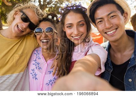 Close up portrait of smiling friends standing side by side