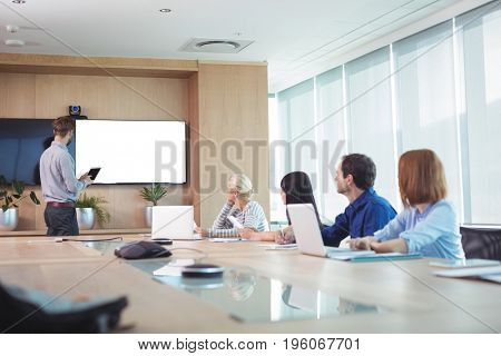 Business people at conference table during meeting in office