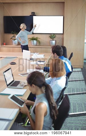 Colleagues at conference table during business meeting in board room