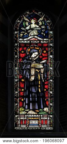 ROME, ITALY - SEPTEMBER 02: Saint Beda Venerabilis on the stained glass of All Saints' Anglican Church, Rome, Italy on September 02, 2016.