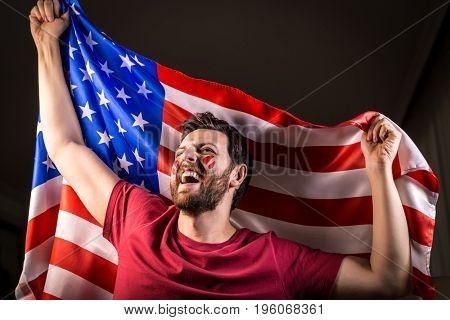 American fan holding the national flag