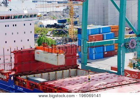 Stockholm, Sweden-July 12, 2017:Container ship Pegasus being loaded with containers in Stockholm Harbor
