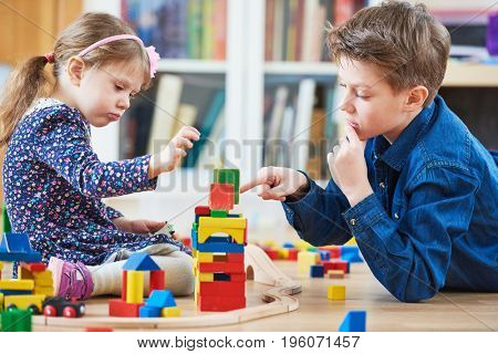 children playing with blocks indoors