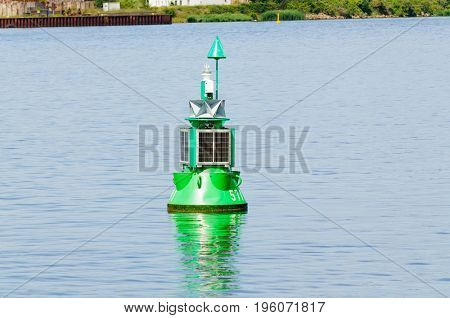 Green Buoy marking the navigational channel in which ships must stay