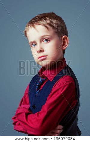 beautiful child wearing a shirt, isolated against grey background