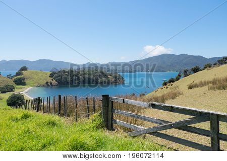 View from Urupukapuka Island in Bay of Islands New Zealand NZ with gate and fence in foreground