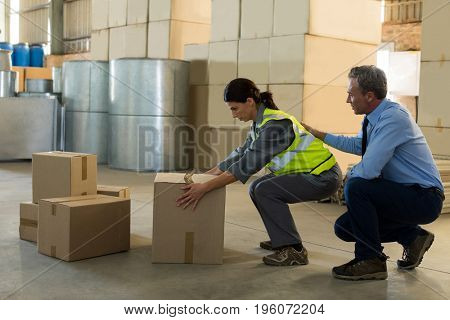 Manager motivating female worker while working in factory