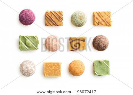 Various sweet candies isolated on white background.