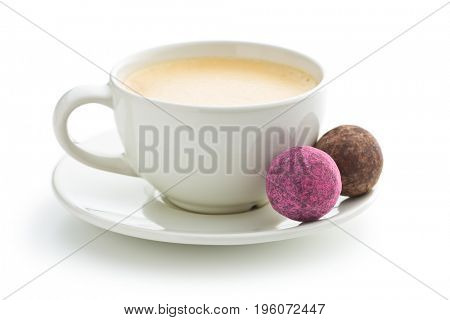 Coffee cup and sweet truffle balls isolated on white background.
