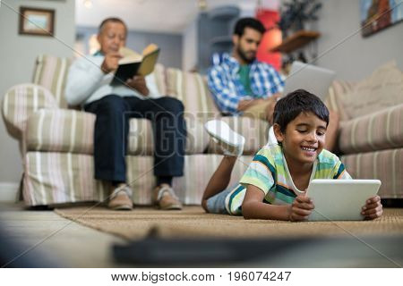 Surface level of family relaxing in living room at home