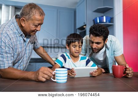 Family using digital table at table