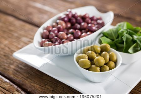 Close-up of marinated olives with herbs in bowl