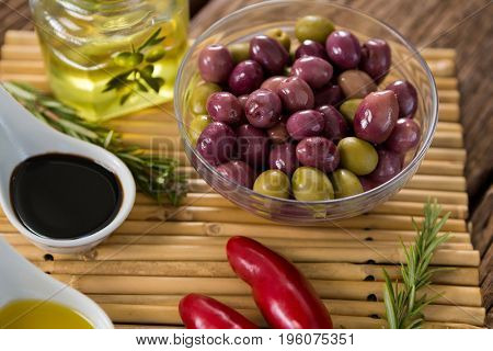 Close-up of marinated olives with ingredients
