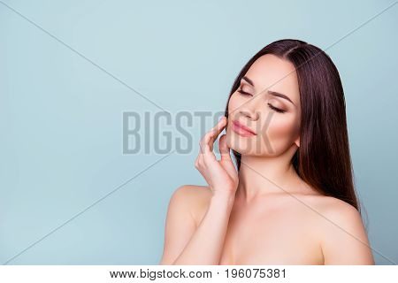 Women beauty and health wellbeing concept. Young pretty brunette lady is touching gently her attractive healthy smooth skin poster