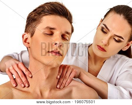 Shoulder and neck massage for man in spa salon. Doctor making neck therapy in rehabilitation center on isolated. Repositioning of the joint in the clinic. Relaxing therapeutic massage.