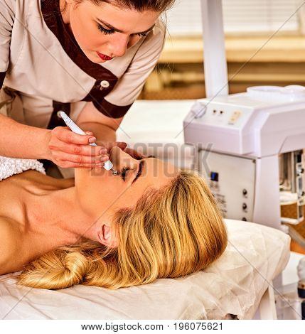 Facial massage at beauty salon. Electric stimulation skin care of woman. Professional equipment for microcurrent lift face without surgery number one . Non surgical treatment for preserve youth.