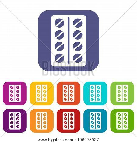Round pills in a blister pack icons set vector illustration in flat style in colors red, blue, green, and other