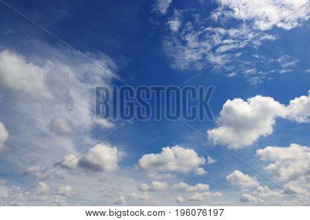 Beautiful clouds in dark blue sky. Heavenly background.
