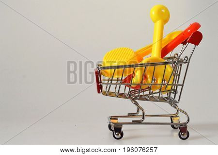 Summer shopping cart with sand toys in it