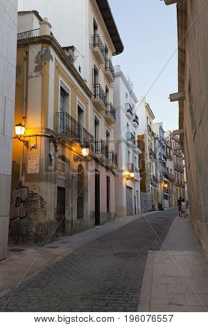 A Street In The Old Town Of Alicante At Dusk
