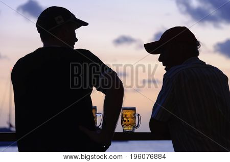Two blokes enjoy a nice cold beer after a long day's hard work - Port Vila, Efate Island, Vanuatu, 28 September 2012