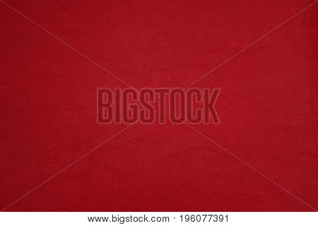 The background of artificial leather in bright red color.