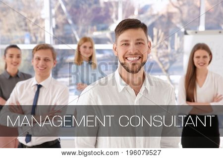 Concept of management consultant. Businessman and team of managers on background