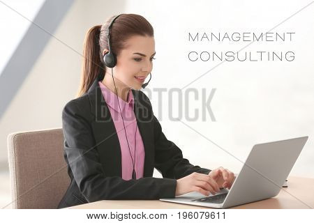 Concept of management consulting. Young woman with headset and laptop working in office