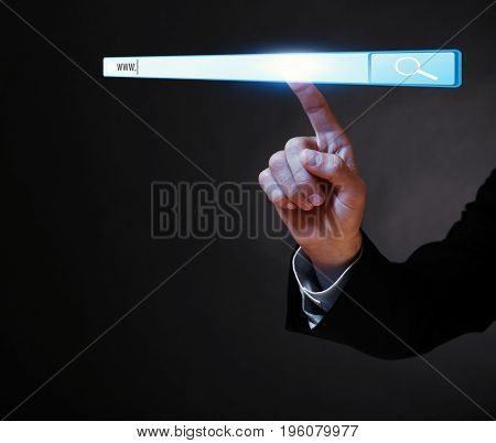 Internet shopping concept. Man clicking on browser search bar, dark background