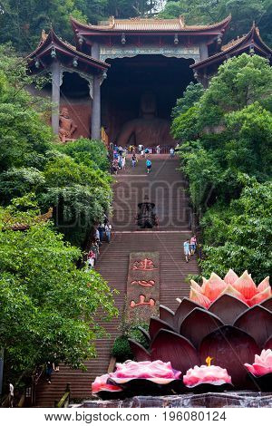 August 2014: lingyun shan mountain temple china visitors and devotees go to the temple. confucianism taoism and buddhism are the three main religions