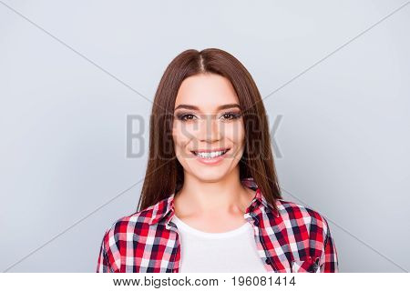 Young Gorgeous Brunette Girl Is Standing On The Pure Light Blue Background And Smiling, Wearing Casu
