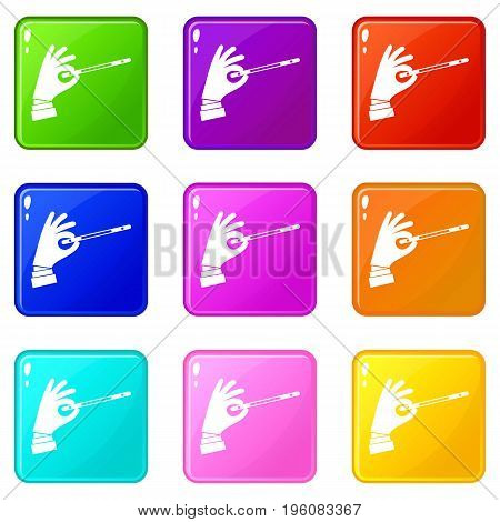 Magician hand with a magic wand icons of 9 color set isolated vector illustration