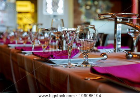 Room With Served Tables In Restaurant, Focus On Glass Center