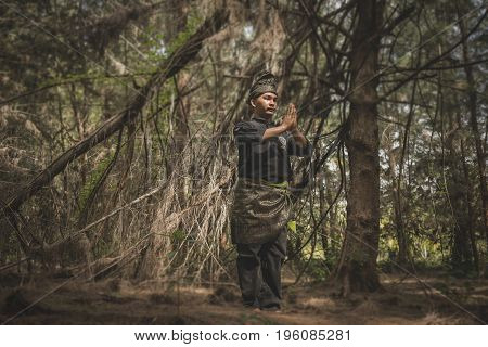 Kampung Mek Mas Kota Bahru Kelantan / Malaysia - July 15 2017 : A shot of a person performing steps of Silat a kind of martial art practised in South East Asia.