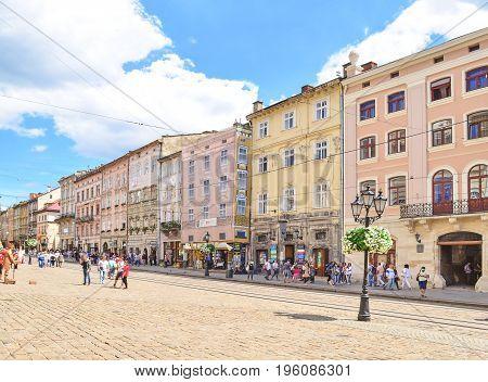 Lviv, Ukraine - July 14, 2017: Historic center of Lviv. Medieval architecture of the Central European cities. Old European city Lviv. Cobbled Lviv street with tram tracks