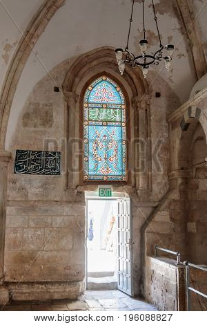 Jerusalem, Israel, July 14, 2016 : Fragment of the interior - stained glass and an exit door - of the Room of the Last Supper in Jerusalem Israel.