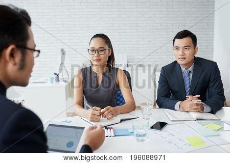 Vietnamese business people having meeting in office