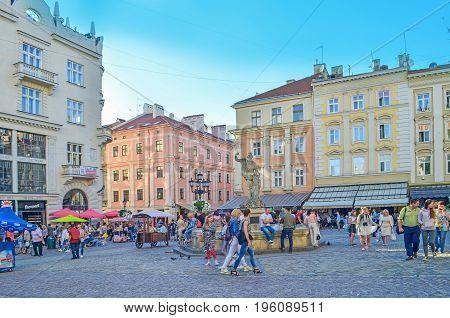LVIV, UKRAINE - July 16, 2017: Lviv city landscape. Lviv old town with people. Colorful historical streets