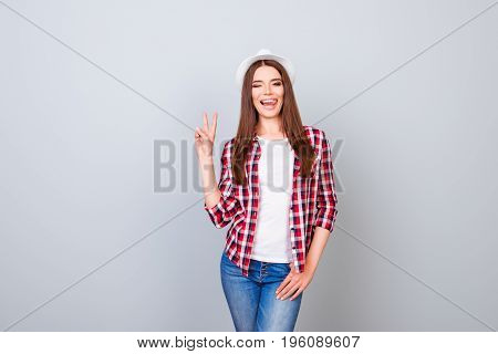 Cheerful Young Girl On Summer Vacation. She Is In A Stylish Hat, Wearing Casual Spring Outfit, Posin