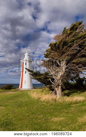The Mersey Bluff Lighthouse standing at the mouth of the Mersey River near Devonport is unusual in Australia with its distinctive vertical red striped day mark.
