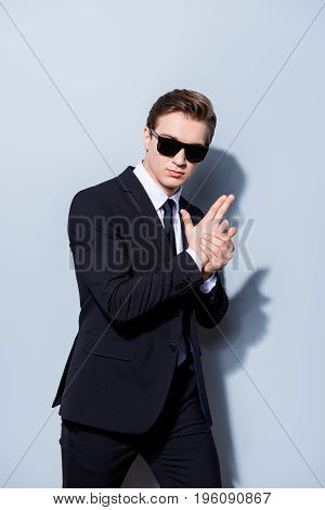 Spy Criminal Policeman Detective Man With Hand Gun In A Classy Suit With Tie And Sun Glasses, Standi