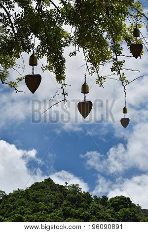 Natural background sky forest and mountain with brass bell. Buddhist temple.