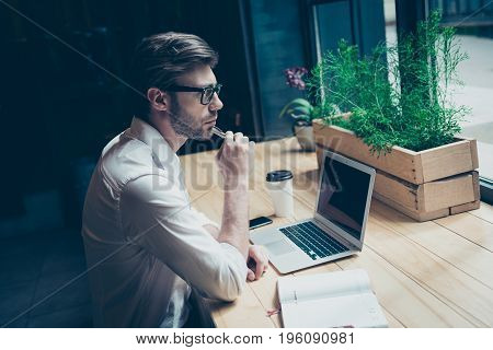Dreamy Ponder Young Man In Formal Wear Is Sitting At His Work Place In A Loft Styled Modern Coworkin