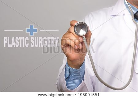 Doctor holding a stethoscope and word