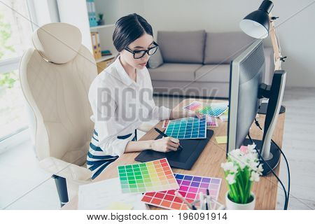 Busy Young Asian Graphic Designer Is Drawing Something On Graphic Tablet At The Office, Focused. She