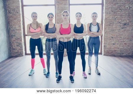 Self Defend Class Concept. Full Length Photo Of Five  Young Sportive Girls, Standing With Crossed Ha
