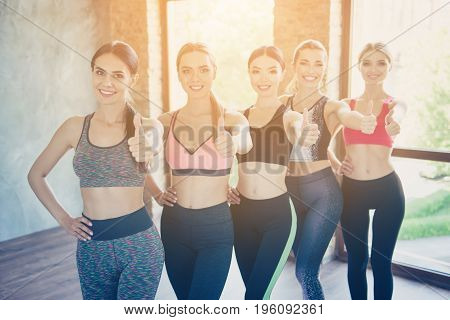 We Like Healthy Sporty Life! Five Hot Ladies In Trendy Sports Outfit Are Showing Thumbups In A Gym,