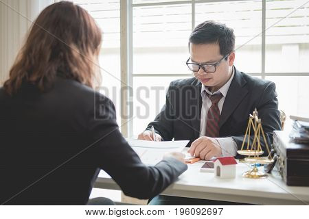 Client and lawyer have a sit down face to face meeting to discuss the legal options available