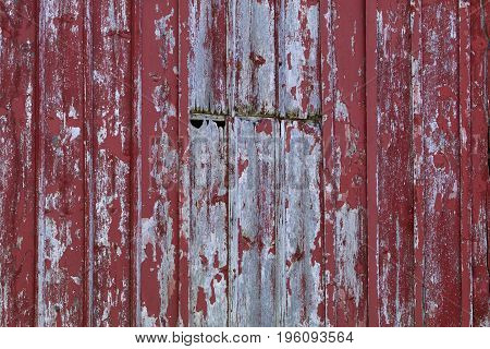 The old weathered barns siding shows gray and red.